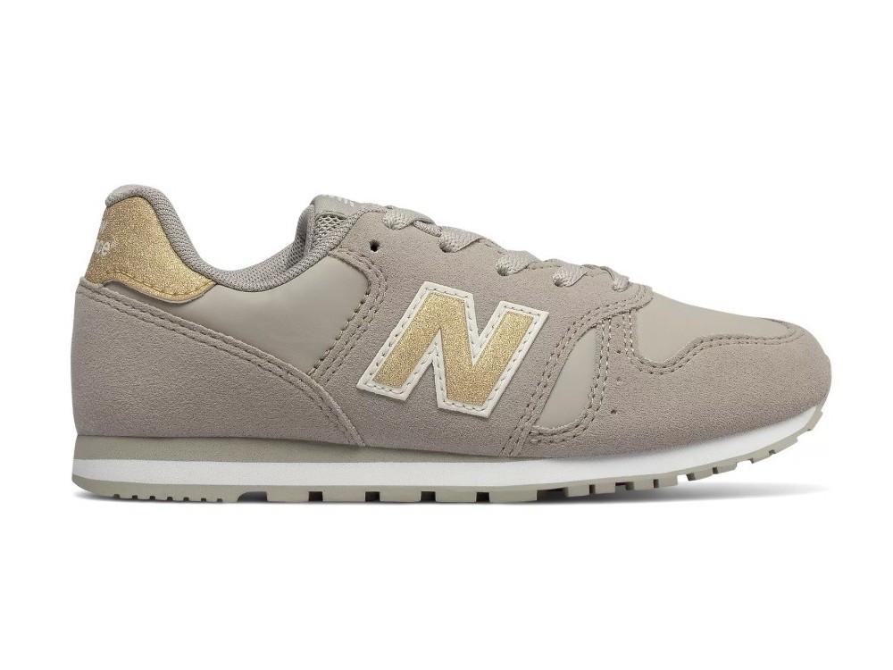 zapatillas new balance de mujer blancas con el logotipo gris